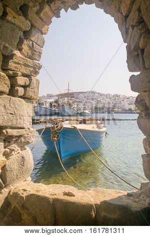 Old boat at Paros island in Greece. View from inside the Kastelli castle.