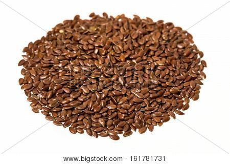 Pile Of Dark Flaxseeds Isolated On White Background