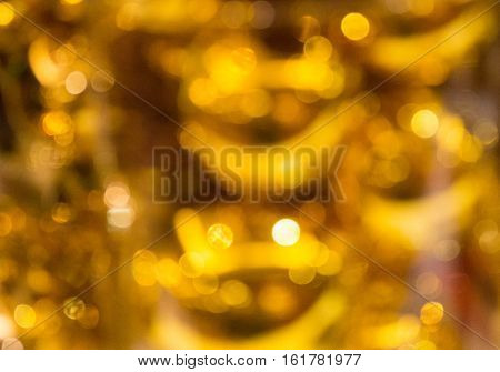 Chrismas Gold background Festive abstract background with bokeh defocused .