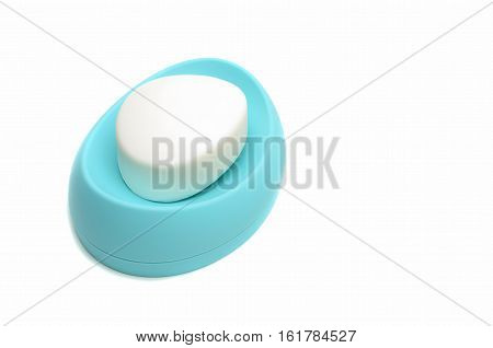 white soap in the soap dish of blue on a white background