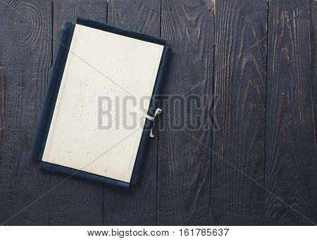 retro folder on old wooden background