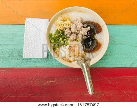 chinese porridge rice gruel on colorful wood