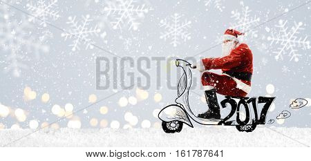 Santa Claus on scooter driving at Christmas or New Year snowy gray background