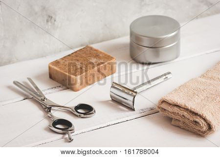 Mens hairdressing wooden desktop with tools for shaving close up