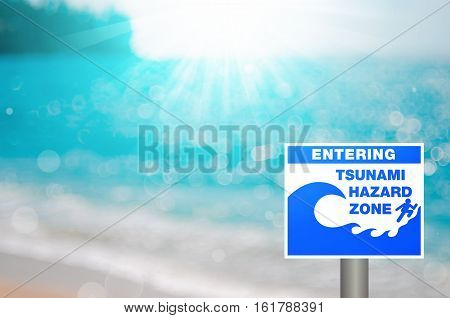 Tsunami Sign On Blur Tropical Beach With Bokeh Sun Light Wave Abstract Background.