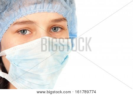 Young surgeon woman with blue eyes looking at camera