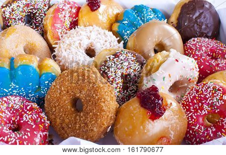 Assorted Colorful Donuts in Box.  Unhealthy food