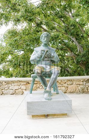 Bronze statue of Blaz Baromic holding a book in Vrbnik town Krk Croatia. One of the first printer calligraphers who founded senj using the glagolitic alphabet in print.
