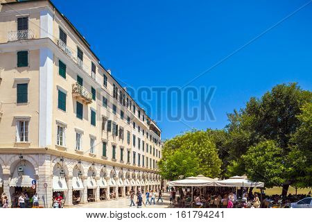 Corfu, Greece - July 1, 2011: Tourists Rest In An Outdoor Cafe Next To The  Liston