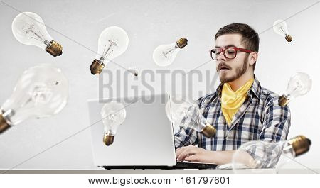 Hipster guy use laptop . Mixed media