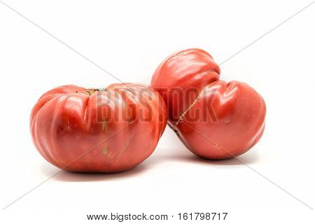 Two Homegrown Heirloom Tomatoes  Isolated On White