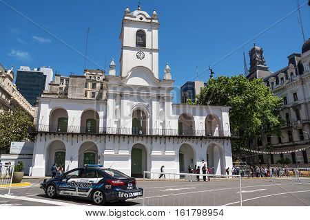 Buenos Aires Argentina - Otober 30 2016: Cabildo of Buenos Aires in a sunday with police car and tourists