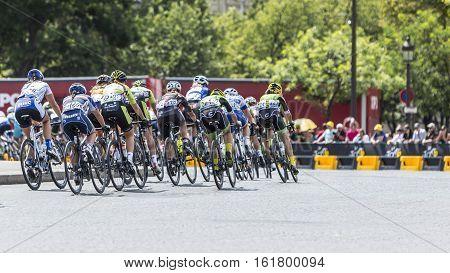 Paris France - July 24 2016: The feminine peloton riding on Champs Elysees in Paris during the second edition of La Course by Le Tour de France 2016.