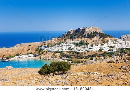 Panoramic view of Lindos town, bay and Acropolis at sunny day, Greece