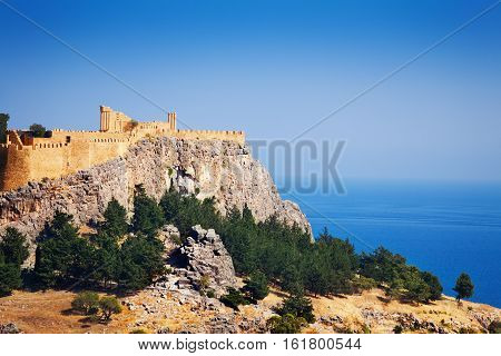 Beautiful view of ancient temple ruins of Lindos Acropolis, Greece