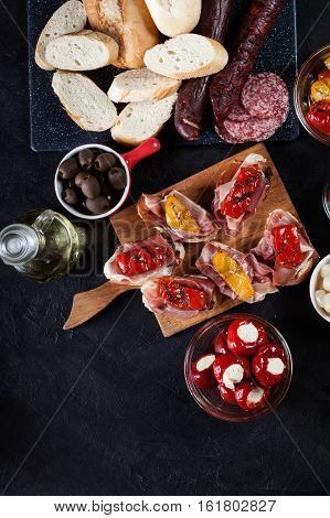 Spanish Tapas With Slices Jamon Serrano And Grilled Pepper. Also