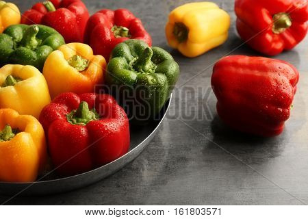 Red, green and yellow sweet bell peppers on table, close up