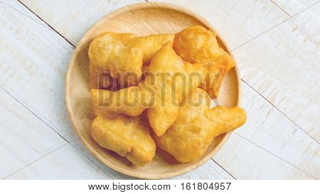 Chinese deep fried dough sticks in wooden dish breakfast in Thailand
