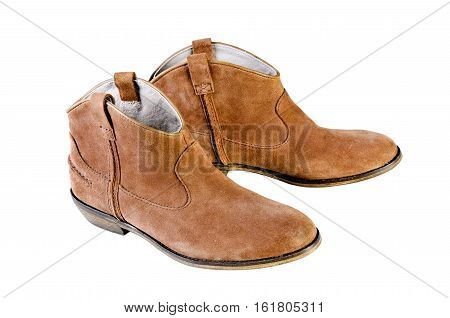 woman brown leather cowboy boots. Womens brown suede fashion boots isolated. Shot in studio on a white background.