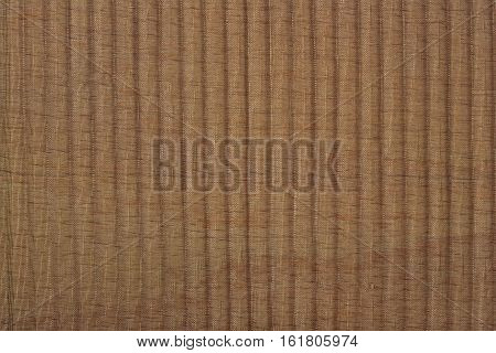 Black Pleated Transparent Caprone Cloth On A Brown Background