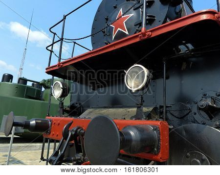 The front part of an old steam train. Closeup. Retro. Ural, Russia