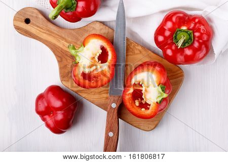 Pepper ratunda ( gogoshar ). Tomato shaped sweet pepper on cutting board. Red bell pepper capsicum or sweet pepper. Top view.