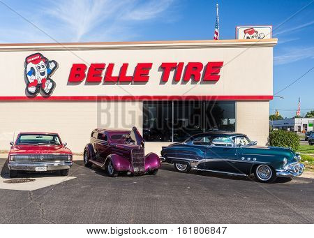 ROYAL OAK MI/USA - AUGUST 18 2016: A 1966 Dodge Charger 1935 Ford Tudor 1951 Buick Super cars at Belle Tire on the Woodward Dream Cruise route. Woodward is a National Scenic Byway.