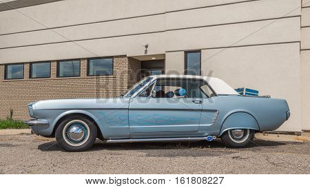 ROYAL OAK MI/USA - AUGUST 18 2016: A 1965 Ford Mustang car with rare rear wheel well covers at the Woodward Dream Cruise. Woodward is a National Scenic Byway.