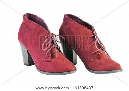 pair of maroon women's boots isolated on a white background. Women's autumn boots isolated on white background
