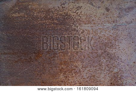 Brown background: metal surface with mint paint and creased texture