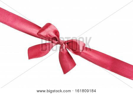 Red silk gift bow on the diagonally red silk ribbon isolated on a white background