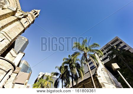 Church with modern building and sky and palms
