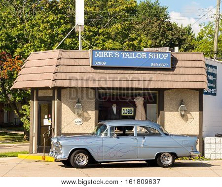 ROYAL OAK MI/USA - AUGUST 18 2016: 1955 Chevrolet Bel Air car at Mike's Tailor Shop on the Woodward Dream Cruise. Woodward is a National Scenic Byway.