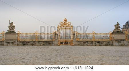 Paris. France, January 14, 2014. Versailles chateau. France. View of golden gate to palace. Royal residence near Paris. King's quarters. Famous tourist renaissance architecture landmark without people on the foreground
