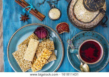 Kozinaki with seeds, nuts, sesame seeds and honey. Studio Photo