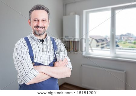 Cheerful Plumber With Crossed Arms