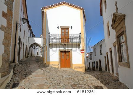MARVAO, PORTUGAL: Typical cobbled streets with whitewashed houses and arcades