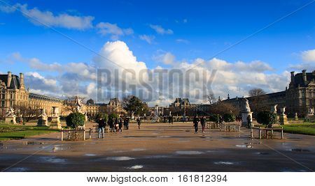 Paris, France, January 12, 2014. Park close to Arc de Triomphe du Carrousel and Louvre after the rain with incredible clouds.