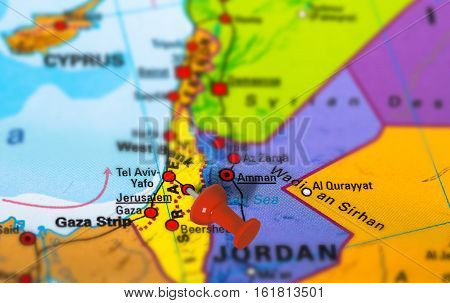 Jerusalem in Israel pinned on colorful political map of Middle East. Geopolitical school atlas. Tilt shift effect.