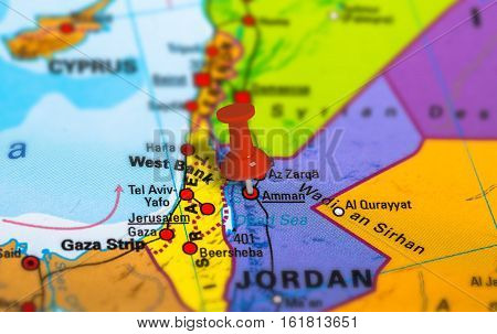 Amman in Jordan pinned on colorful political map of Middle East. Geopolitical school atlas. Tilt shift effect.
