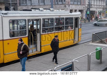 Yellow Budapest Tram And Passengers