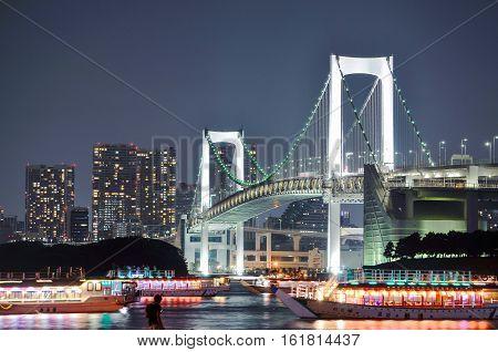 A night view of Rainbow Bridge in man-made Island Odaiba, Tokyo