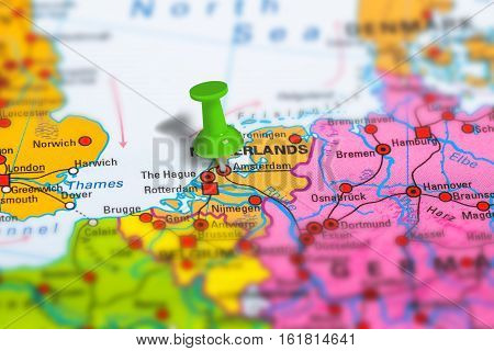 Amsterdam in Netherlands pinned on colorful political map of Europe. Geopolitical school atlas. Tilt shift effect.