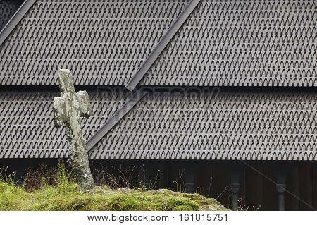 Norwegian graveyard and stave church roof. Fantoft. Bergen. Visit Norway
