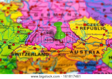 Munich in Germany pinned on colorful political map of Europe. Geopolitical school atlas. Tilt shift effect.
