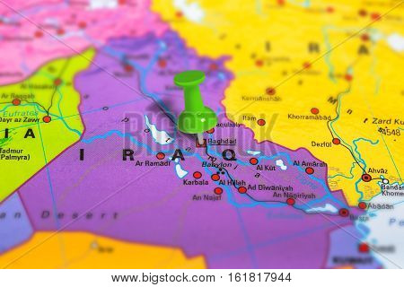 Baghdad in Iraq pinned on colorful political map of Europe. Geopolitical school atlas. Tilt shift effect.