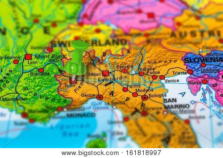 Turin in Italy pinned on colorful political map of Europe. Geopolitical school atlas. Tilt shift effect.