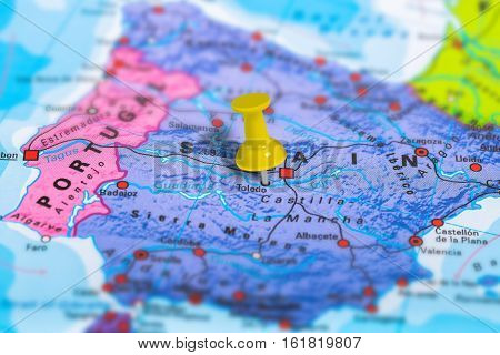 Toledo in Spain pinned on colorful political map of Europe. Geopolitical school atlas. Tilt shift effect.