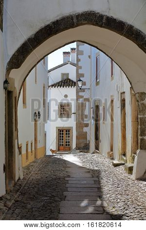 MARVAO, PORTUGAL: A typical narrow cobbled street with whitewashed houses and arcades