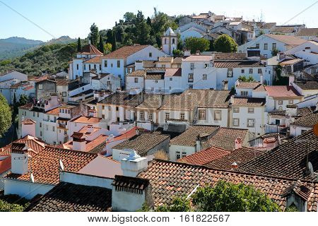 CASTELO DE VIDE, PORTUGAL: View of the Old Town with whitewashed houses and tiled roofs